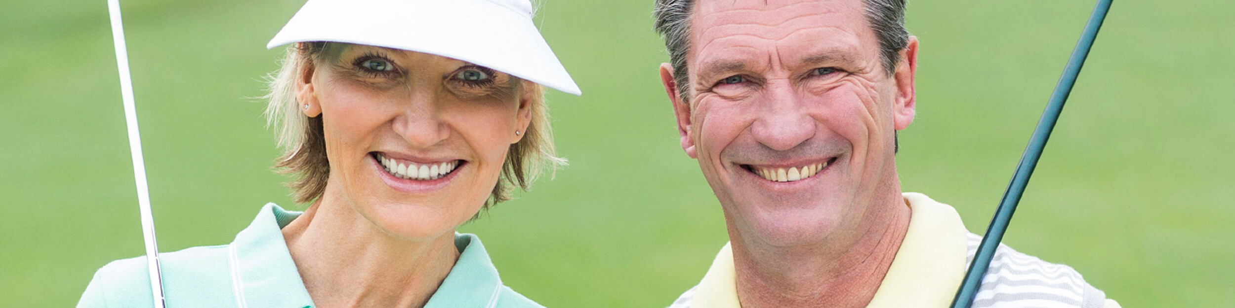 woman and man in golfing gear