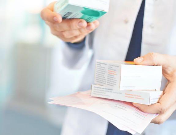 Pharmacist filling prescriptions