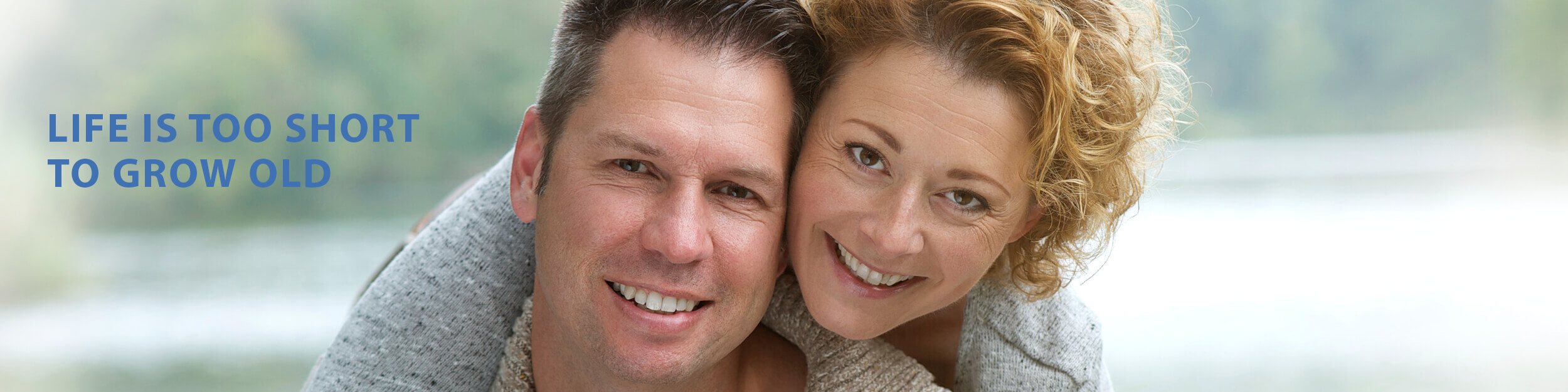 Middle aged woman and man smiling